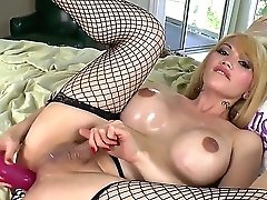 Gorgeous Looking Blonde She-masculine Eva Lin In Sexy Fishnet Stockings Spreads Her Gams With Open While Erotically